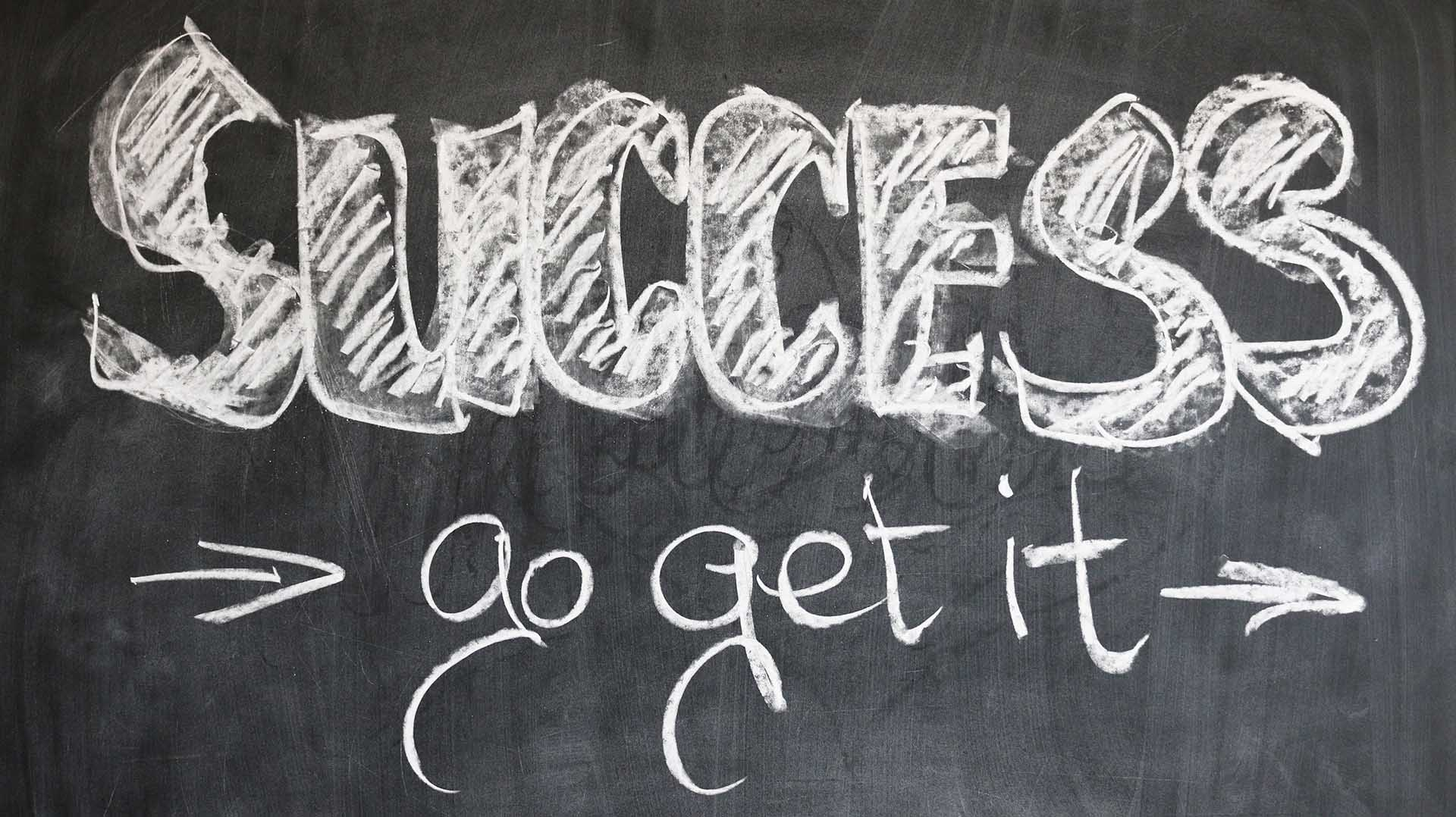 Photo of the word success written on a blackboard