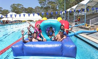 Kids having fun at aquatic centre