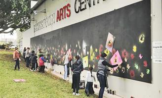 Photo of 'We are still here and we still have support' mural