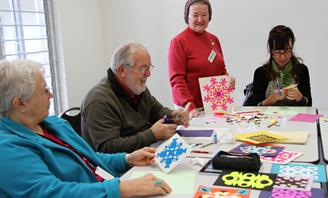 Photo of senior people doing craft