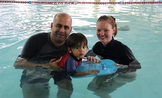 Image of Mayor in pool with child and instructor