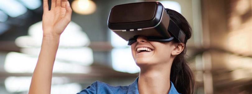 Photo of woman wearing VR goggles