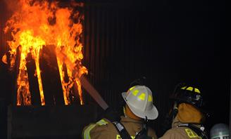 Photo of Fire fighters putting out blaze