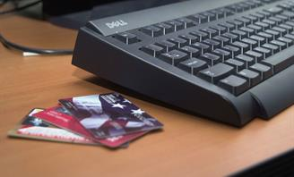 Credit cards next to keyboard