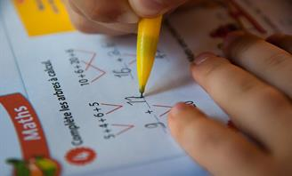 Photo of a child completing their homework