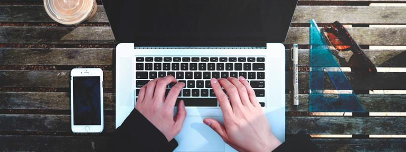 Photo of a person using a computer