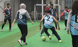 Photo of youths playing indoor soccer