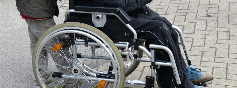Photo of a person sitting in a Wheelchair