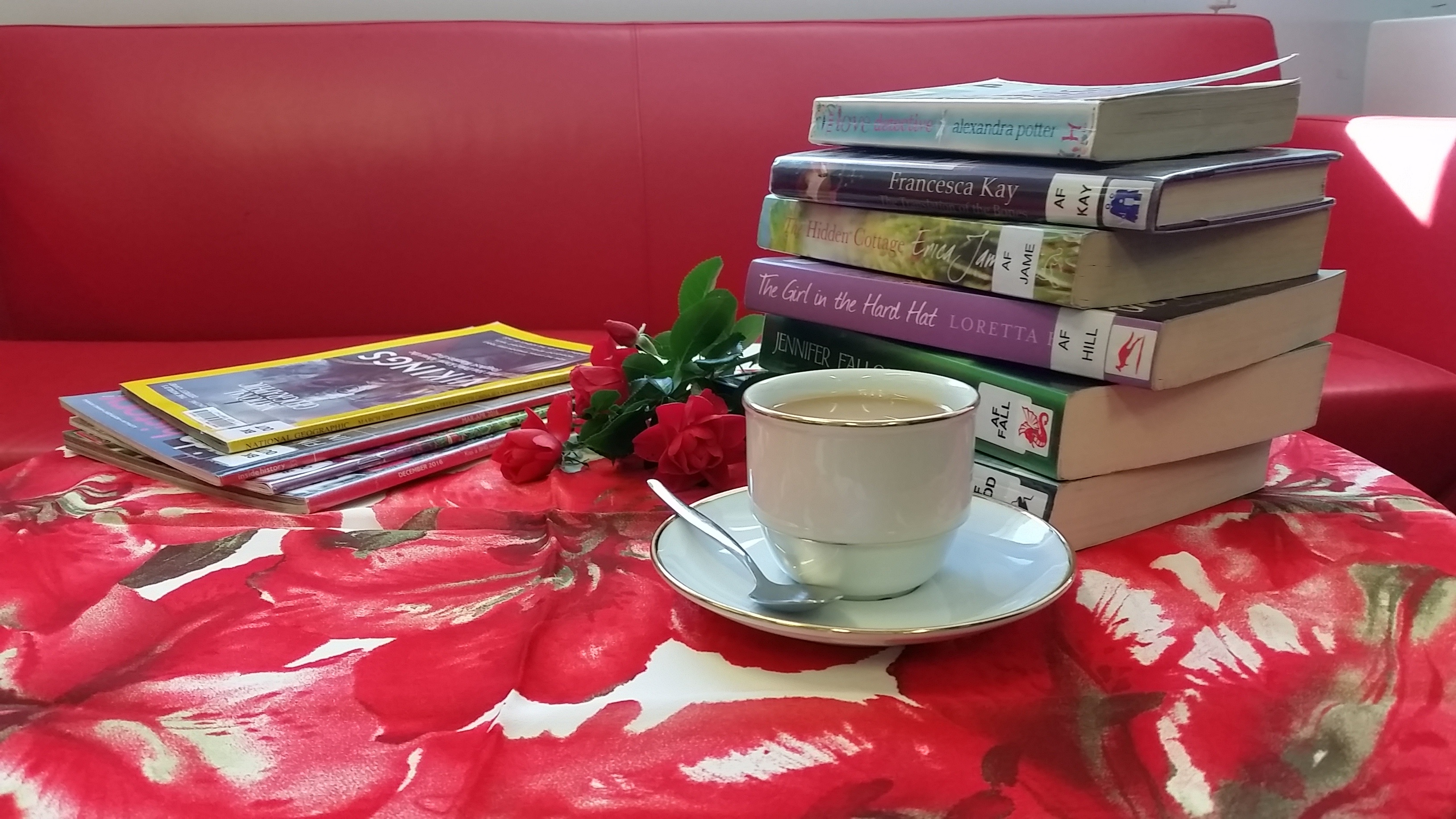 A cup of tea in front of library books