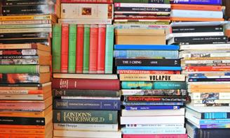 Stack of books with different colour spines