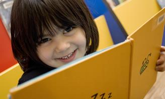 Photo of a young girl reading a book