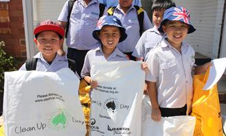 Photos of children taking part in Clean Up Australia Day
