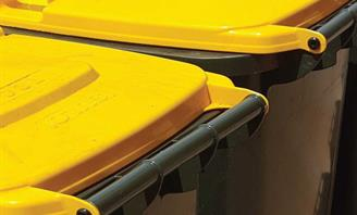 Photo of yellow lid recycling bin