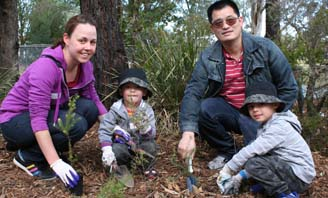 Family taking part in tree planting