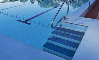 Photo of a swimming pool and steps