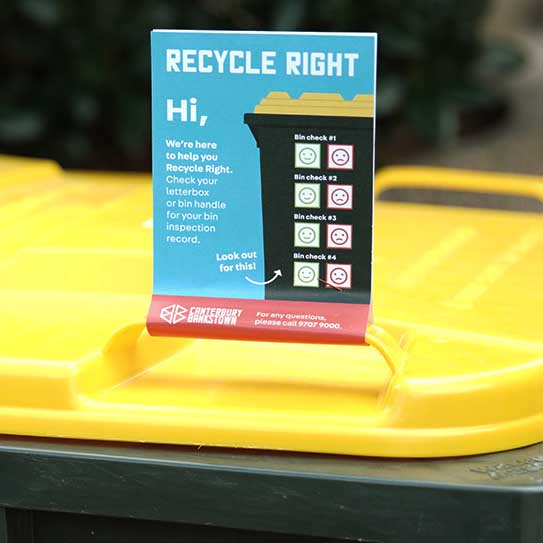 Photo of Recycle Right flyer attached to bin