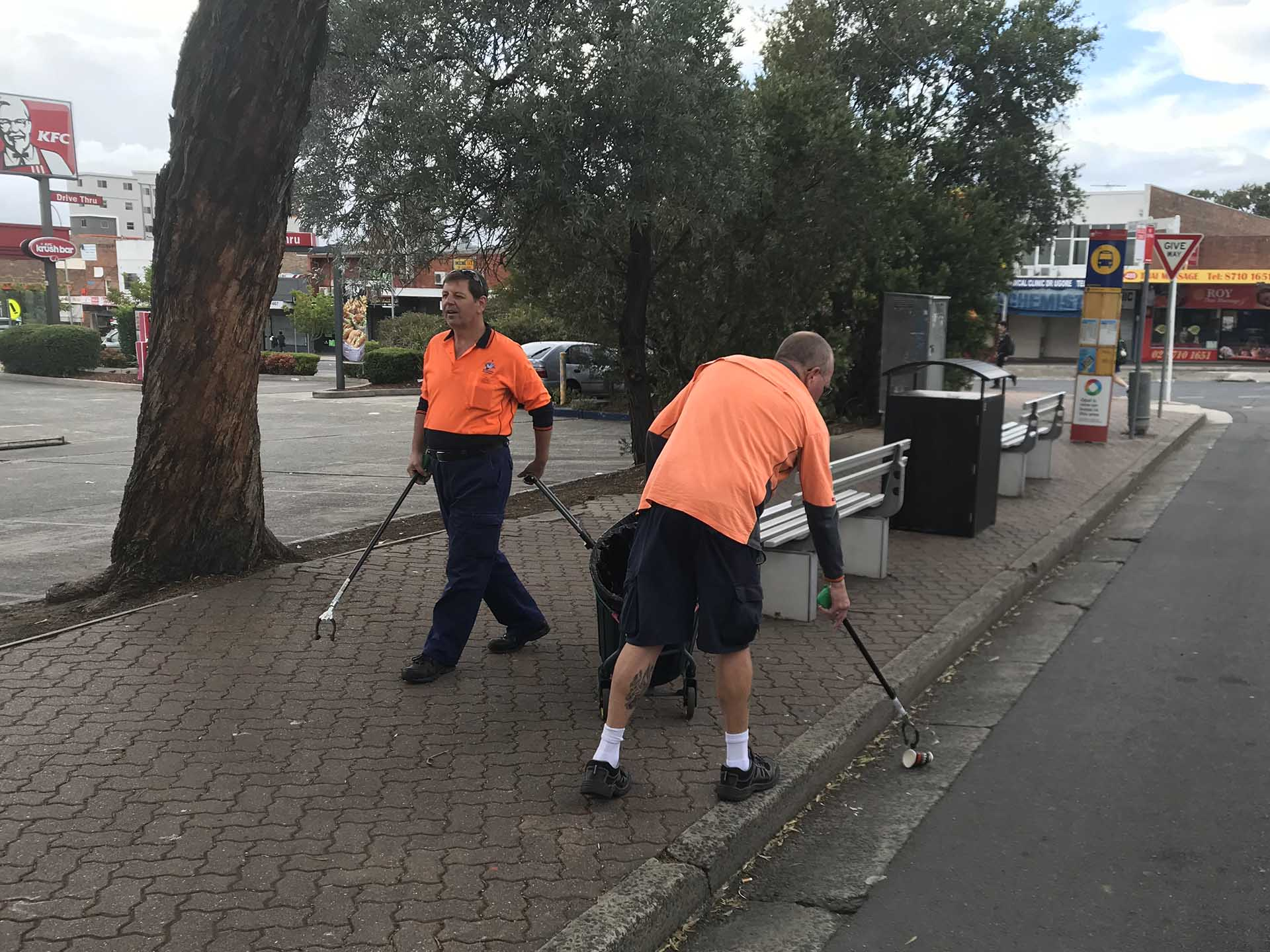 Photo or workers conducting street cleaning