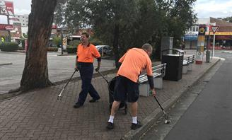 Photo of men cleaning street